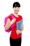 Charming young teenage girl ready to attend college