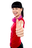Carefree teenager flashing thumbs up sign