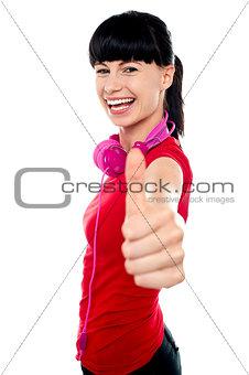 Carefree teenager flashing thumbs up sign