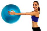 Fitness enthusiast holding a swiss ball