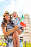 Portrait of happy mother and baby girl with italian flag in fron