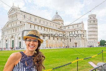 Portrait of happy young woman on piazza dei miracoli, pisa, tusc