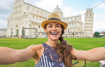 Portrait of happy young woman making selfie on piazza dei miraco