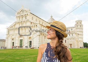 Portrait of happy young woman in front of duomo di pisa, pisa, t