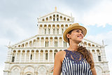 Happy young woman in front of duomo di pisa, pisa, tuscany, ital