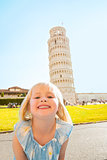Portrait of happy baby girl in front of leaning tower of pisa, t