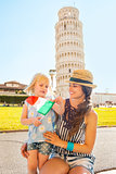 Portrait of mother and baby girl with italian flag in front of l