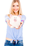 Beautiful woman holding  a piggy bank