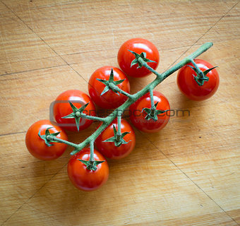 tomatoes on brown textured wood