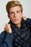 Portrait of good looking blonde man wearing a scarf