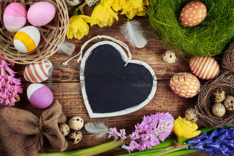 Chalk board in the shape of hearts and Easter decorations