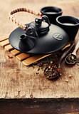 Chinese clay teapot and dry tea