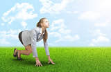 Woman on grass field with blue sky, clouds