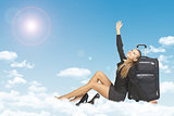 Woman leaned on luggage bags. Clouds, sky, sun as backdrop