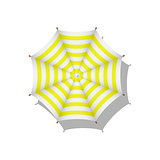Yellow and white striped beach umbrella