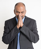 Indian businesspeople praying