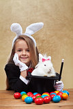 Young magician after successfully conjuring an easter rabbit