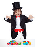 Young magician boy performing an easter trick