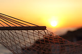 Close up of a hammock on the beach at sunset