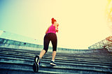 woman runner running on stairs