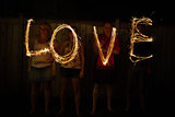 The word Love in sparklers time lapse photography