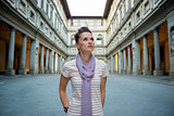 Portrait of young woman near uffizi gallery in florence, italy l
