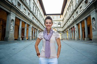 Portrait of smiling young woman near uffizi gallery in florence,