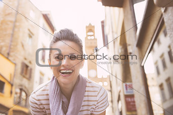 Portrait of smiling young woman not far from palazzo vecchio, in