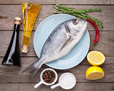 Fresh dorado fish cooking with spices and condiments