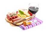 Red wine with cheese, prosciutto, bread, vegetables and spices
