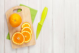 Sliced orange on cutting board