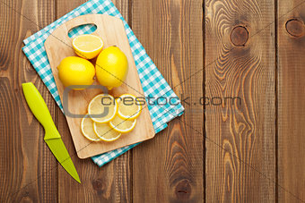 Sliced lemon on cutting board
