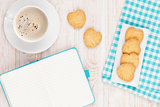 Coffee, heart shaped cookies and notepad