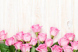Pink roses bouquet over wooden table