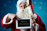 Portrait Santa Claus pointing on slate