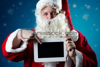 Portrait Santa Claus pointing on slate