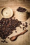 pile of fresh and bio aromatic coffee beans and spoon and jar