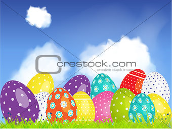 3D Easter eggs selection on a blue sky and clouds