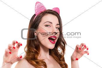 Cat-woman make-up on beautiful young girl. lipstick, nailpolish