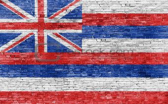Flag of Hawaii on brick wall