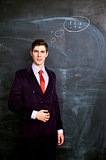Businessman witn chalkboard  on background