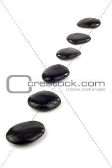 Black pebbles in a row