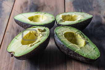 Slives of ripe avocado on rustic surface