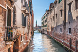 Venetian canal Rio de la Pleto. Old walls with balcony and architecturical elements. Venice, Veneto, Italy