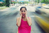Portrait business woman screaming at street car traffic