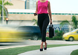 Business woman female commuter going to office by walk