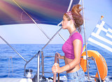 Sexy girl behind yacht helm