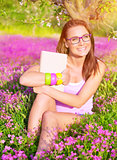 Beautiful student girl on flower field