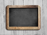old chalkboard or blackboard on white wood
