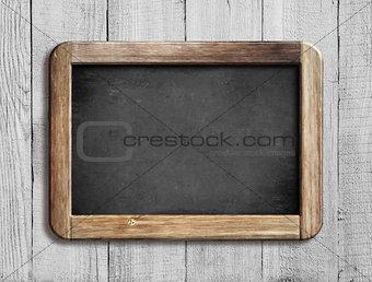 old chalkboard or blackboard on white wood